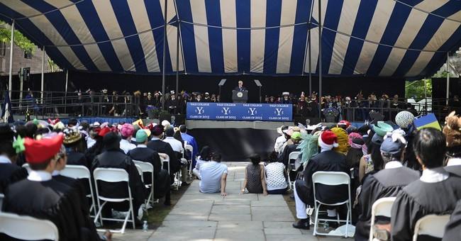Biden urges Yale grads to question judgment, not motives