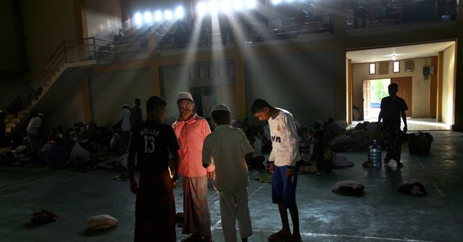 AP PHOTOS: Migrants arrive in Indonesia after ordeal at sea