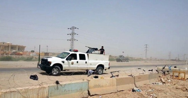 IS militants look for collaborators after taking Iraqi city