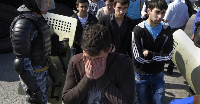 Crimean police detain Tatars commemorating mass deportation