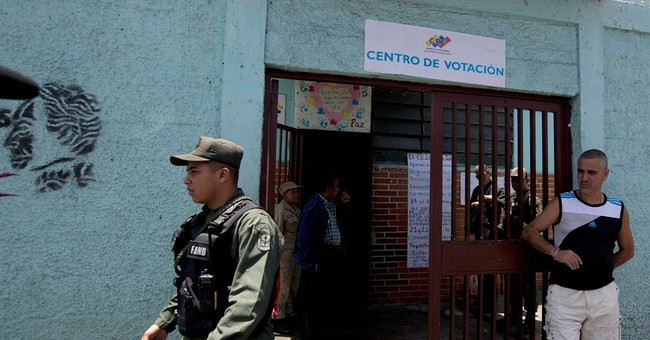 Behind bars, on the ballot; ex-mayor wins Venezuela primary