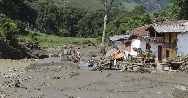 Flood, mudslide sweep away homes in Colombia, killing 58