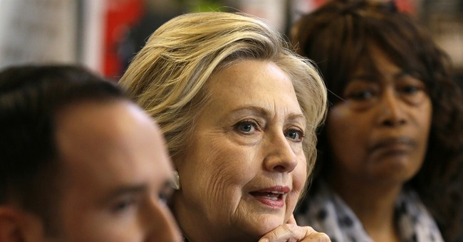 Clinton defends financial regs for big banks, dodges trade