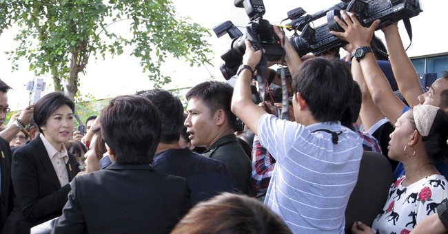 Thai ex-PM starts trial for role in rice subsidy scheme