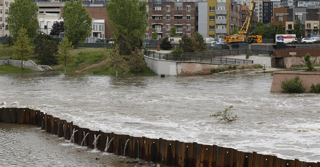 Western storm raises flood danger; kayakers, skiers play