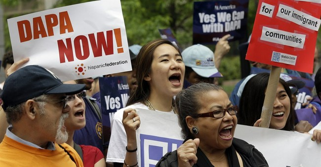 Immigrants rally for reprieve blocked by lawsuit