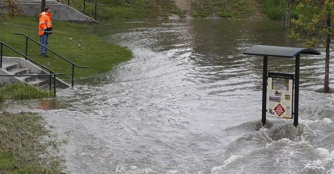 Western storm raises flood danger; kayakers, skiers play