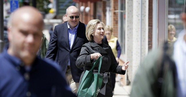 Amid criticism, Clinton sticks to low-key campaign strategy