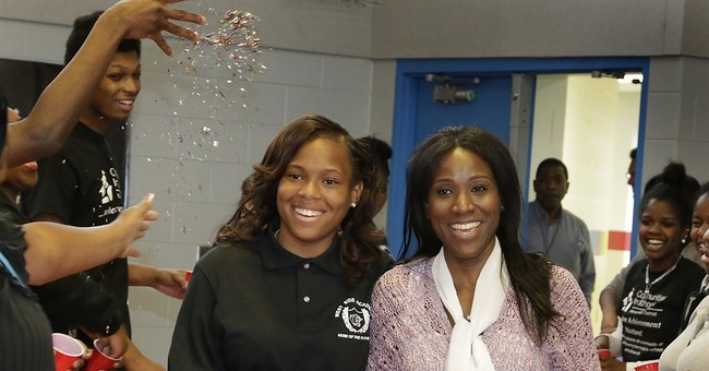 Student back in school, with gym teacher who gave her kidney