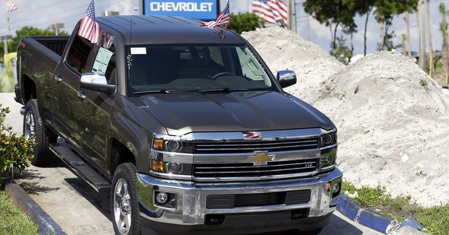GM sets company sales record but falls behind Volkswagen