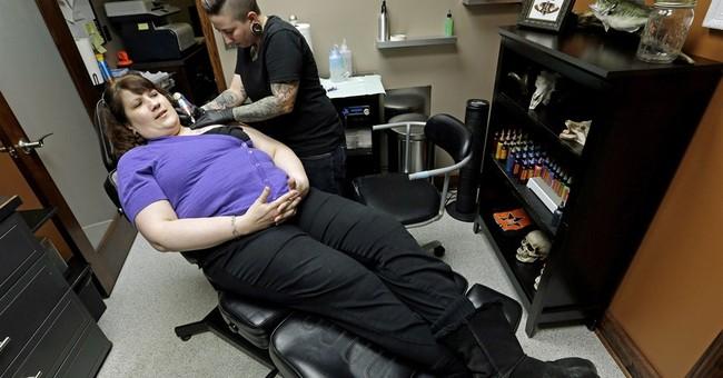 Colorado group helps breast cancer survivors get tattoos