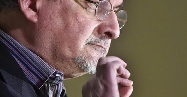 Salman Rushdie, threatened over book, defends free speech