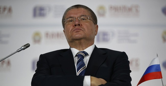 Russia appeals for calm as crisis forces it to cut budget