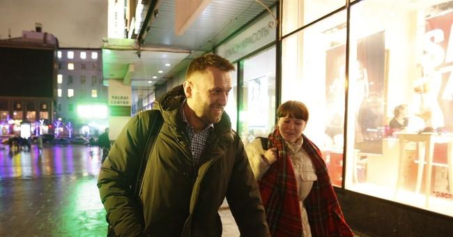 Kremlin turns up heat on Navalny with interrogation, raid