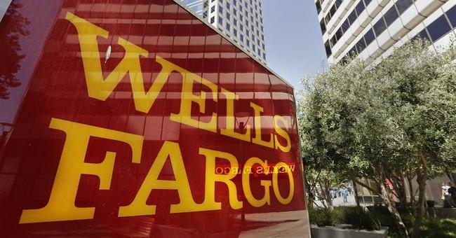 Wells Fargo's earnings edge up as revenue rises