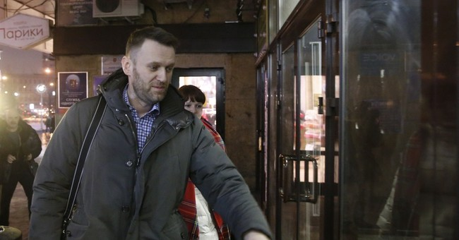 Navalny says he pays back Russia for house-arrest bracelet