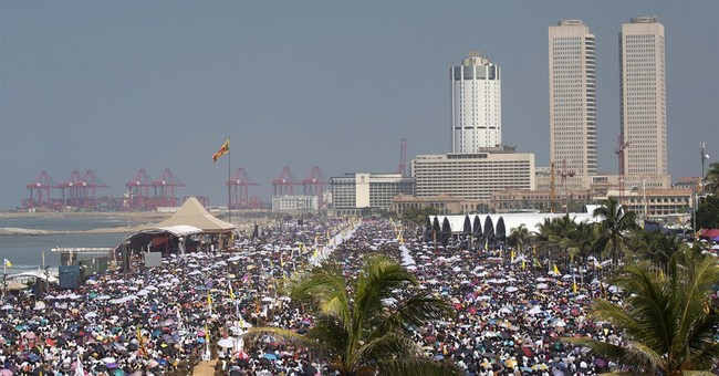 Image of Asia: Crowding into a seafront park to see the pope
