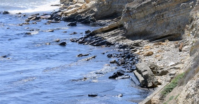 Oil slicks spread 9 miles off California, foul beaches, air