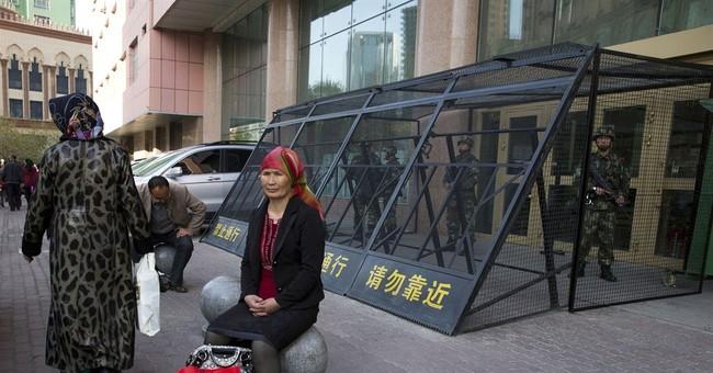 China denying passports to restrict critics, minorities