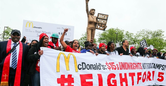 Hundreds march at McDonald's headquarters about low wages