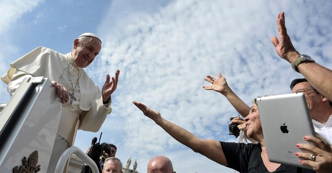Pope's No. 2 offers new insights into climate encyclical