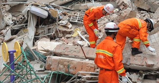 9-story building collapses in China; 16 people missing