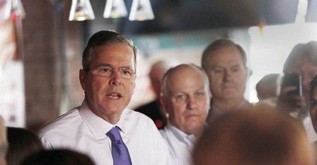 Jeb Bush shifts style, critiques brother's budget management