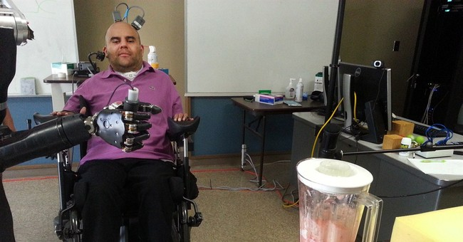 Paralyzed man uses his thoughts to control a robotic arm