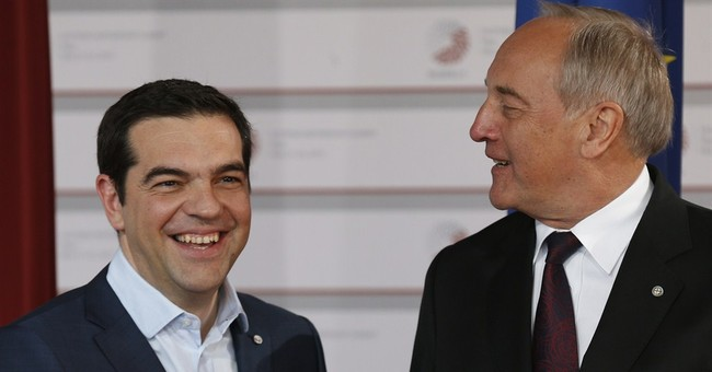 Merkel, Hollande and Tsipras talk about Greek bailout woes