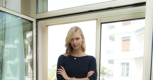 Karlie Kloss towers over other celebs in stylish amfAR look