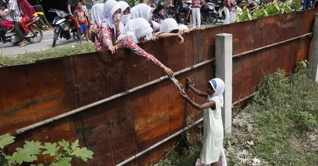 The Latest on Rohingya: UN estimates 3,000 still adrift