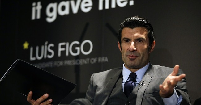 Figo tells AP he is quitting FIFA presidential race