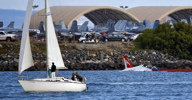 Navy says pilot safely ejected when plane went off runway