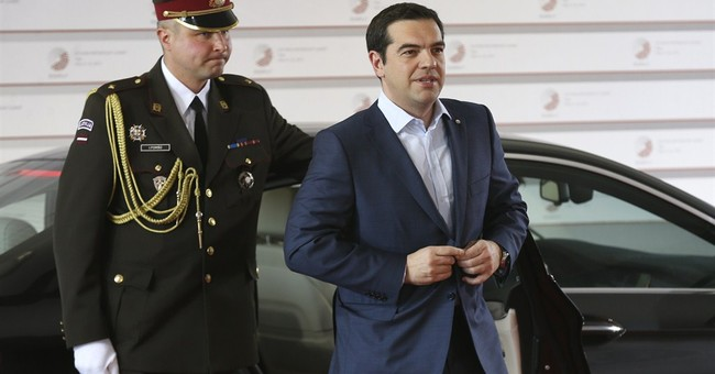 Merkel warns 'whole lot left' to do on Greece bailout talks