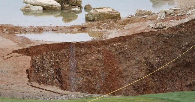 Giant hole forms at entrance of Missouri golf course
