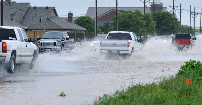The Latest on flooding: Music festival evacuated in Oklahoma