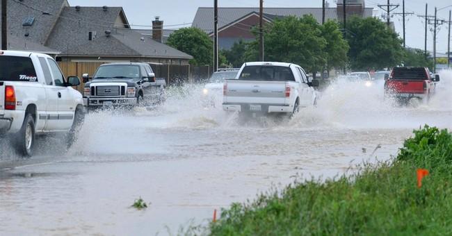 The Latest on flooding: Music festival evacuated in Oklahoma