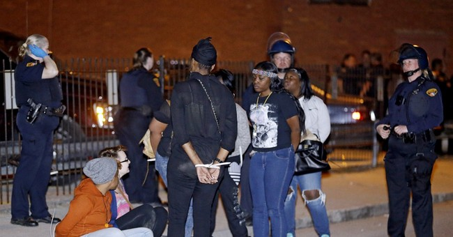 58 protesters arraigned after Cleveland officer's acquittal