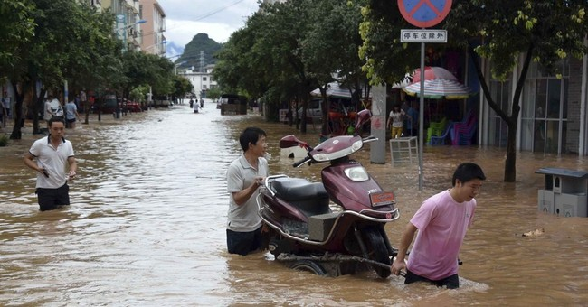 52 dead in China floods, including 2 kids on overloaded bus