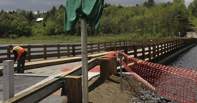 Vermont town's famous floating bridge reopens with fanfare