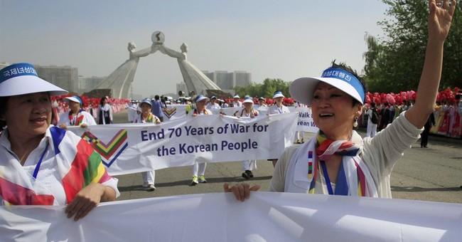 Women's walk across Koreas' DMZ denied; they cross by bus