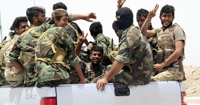 The Latest on IS: Militia name for Anbar fight draws ire