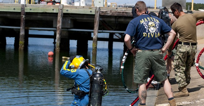 Navy divers to help raise confederate warship artifacts