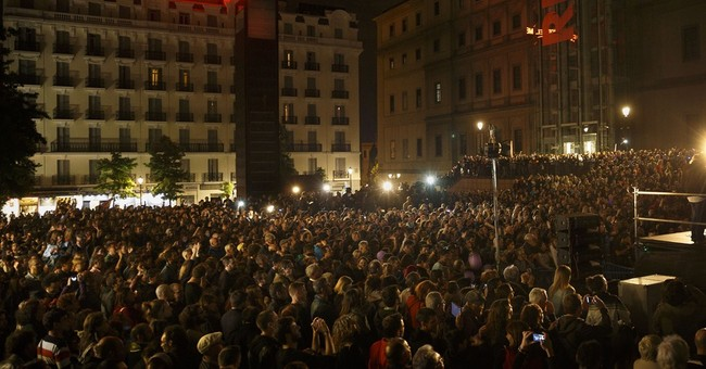 Spain leader blames austerity, scandals for election result