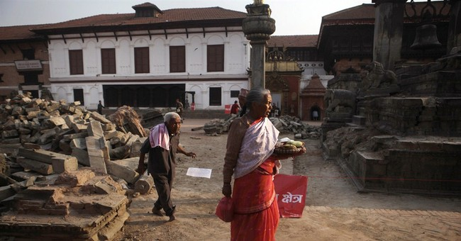 Candlelight vigil marks 1 month since deadly Nepal quake