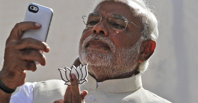 AP PHOTOS: India's Modi shows media savvy in his first year