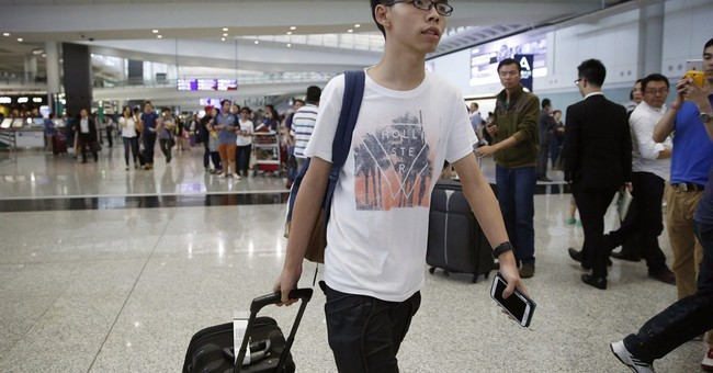 Malaysia refuses entry to teen leader of Hong Kong protests