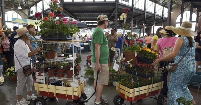 Consumer confidence edges up in May on improving job market