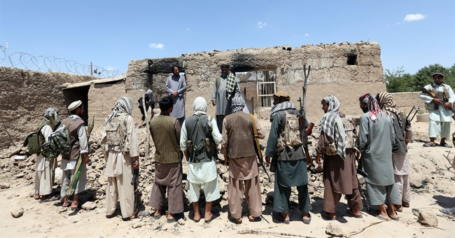 Afghan forces struggle as Taliban seeks northern stronghold