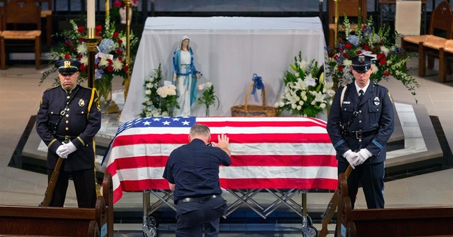 Slain Omaha officer who was new mom honored at her funeral